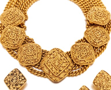 View 2. Thumbnail of Lot 66. Gold-tone metal necklace and two pairs of earrings.