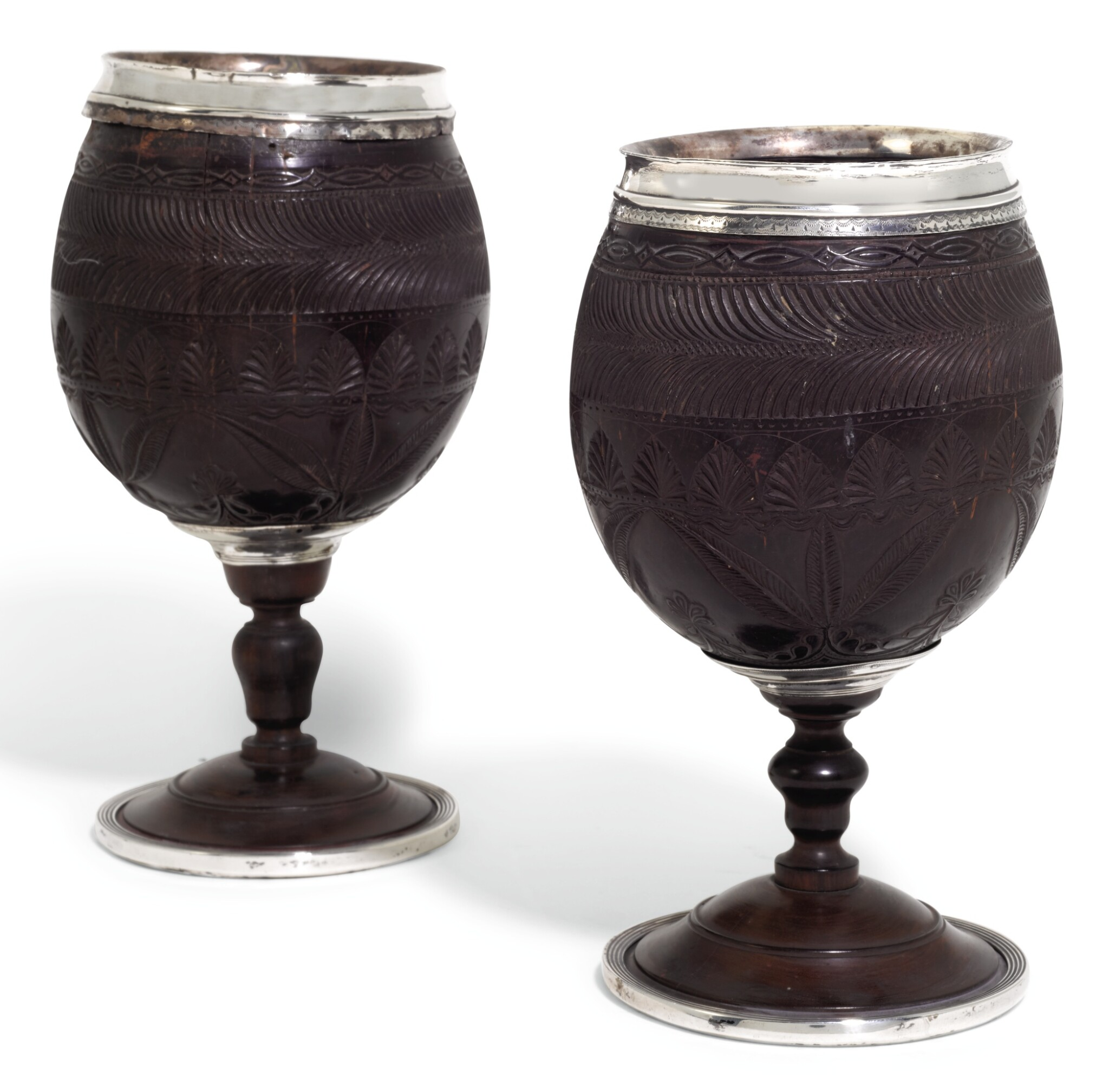 View full screen - View 1 of Lot 144. A PAIR OF GEORGE III SILVER MOUNTED CARVED COCONUT CUPS, THE MOUNTS UNMARKED, CIRCA 1790.