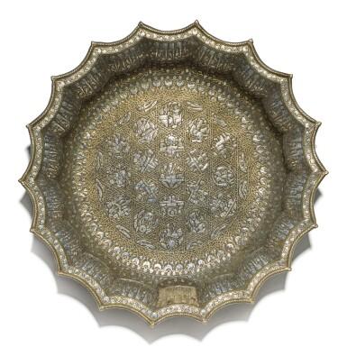 View 4. Thumbnail of Lot 74. A rare and important Khurasan silver-inlaid brass basin, probably Herat, circa 1200.