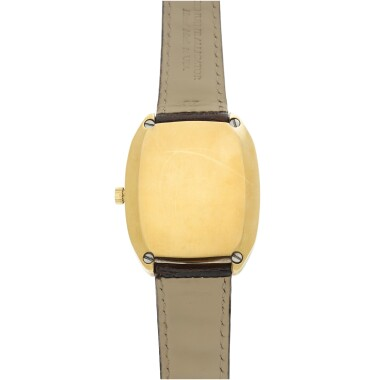 View 5. Thumbnail of Lot 92. REFERENCE R3003 A YELLOW GOLD TONNEAU SHAPED WRISTWATCH WITH DATE, CIRCA 1970.