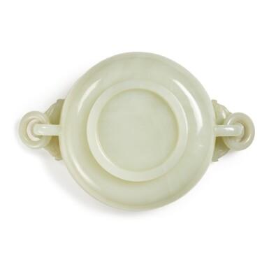 View 6. Thumbnail of Lot 7. A white jade marriage bowl, Qing dynasty, 18th / 19th century   清十八 / 十九世紀 白玉雕年年有餘紋龍耳活環洗.