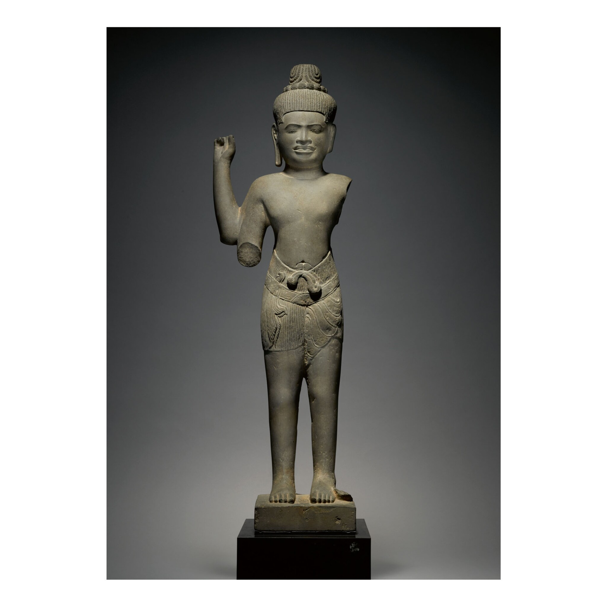 View full screen - View 1 of Lot 344. A GREY SANDSTONE FIGURE OF SHIVA,  KHMER, BAPHUON STYLE, CIRCA 11TH CENTURY.