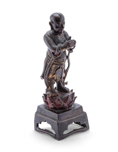 View 1 of Lot 107. Figure de serviteur en bronze patiné Dynastie Ming, XVIIE siècle | 明十七世紀 銅佛教人物立像 | A bronze figure of an attendant, Ming Dynasty, 17th century.