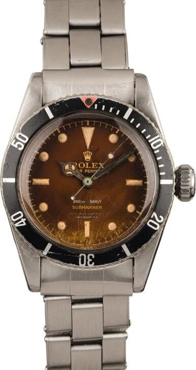 "View 2. Thumbnail of Lot 4. ROLEX | Submariner, Ref. 6538, A Stainless Steel Wristwatch with 4-Line ""Tropical"" Dial and Bracelet, Circa 1958."