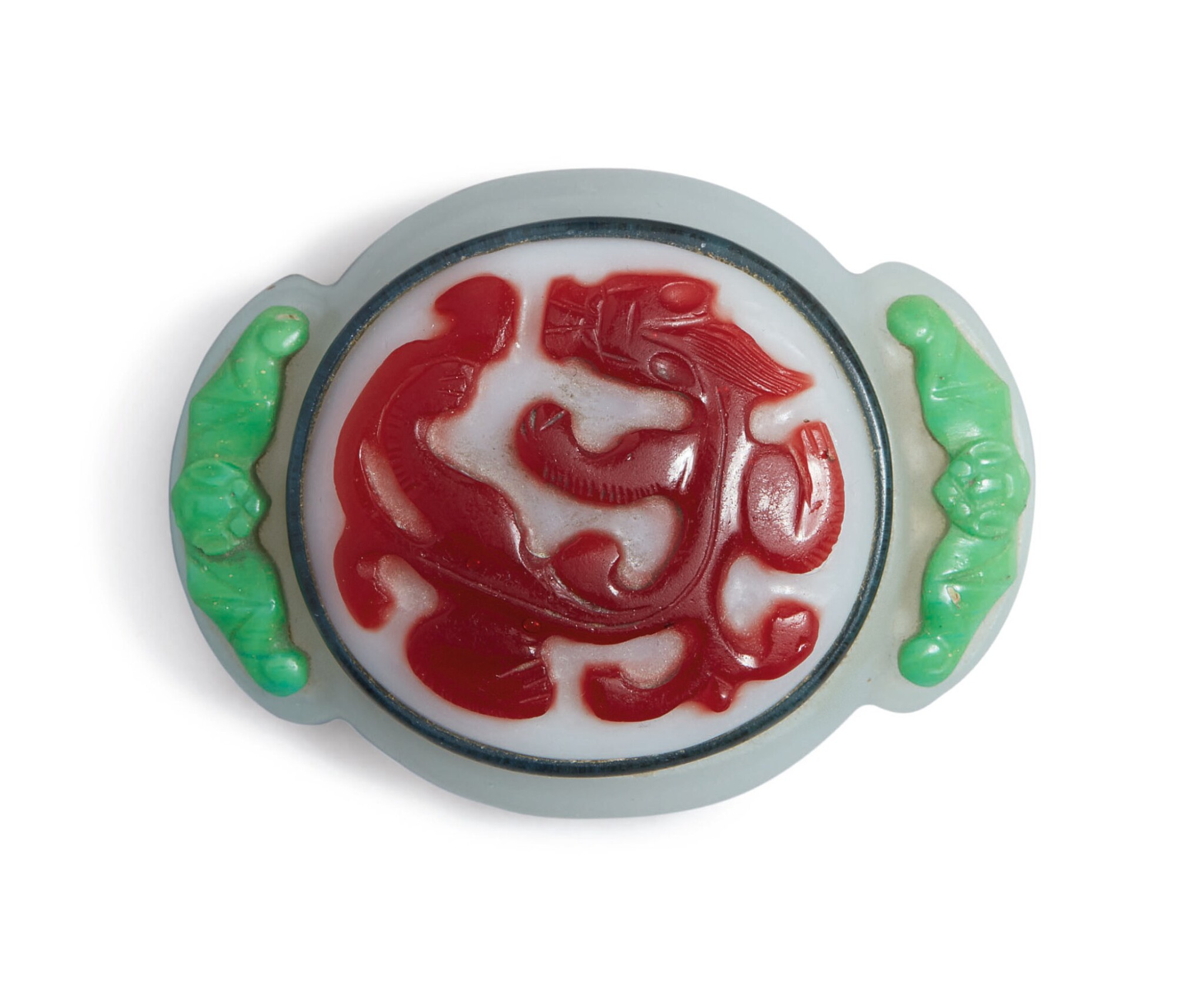 View 1 of Lot 1021. AN UNUSUAL POLYCHROME OVERLAY GLASS 'CHILONG' BELT BUCKLE.