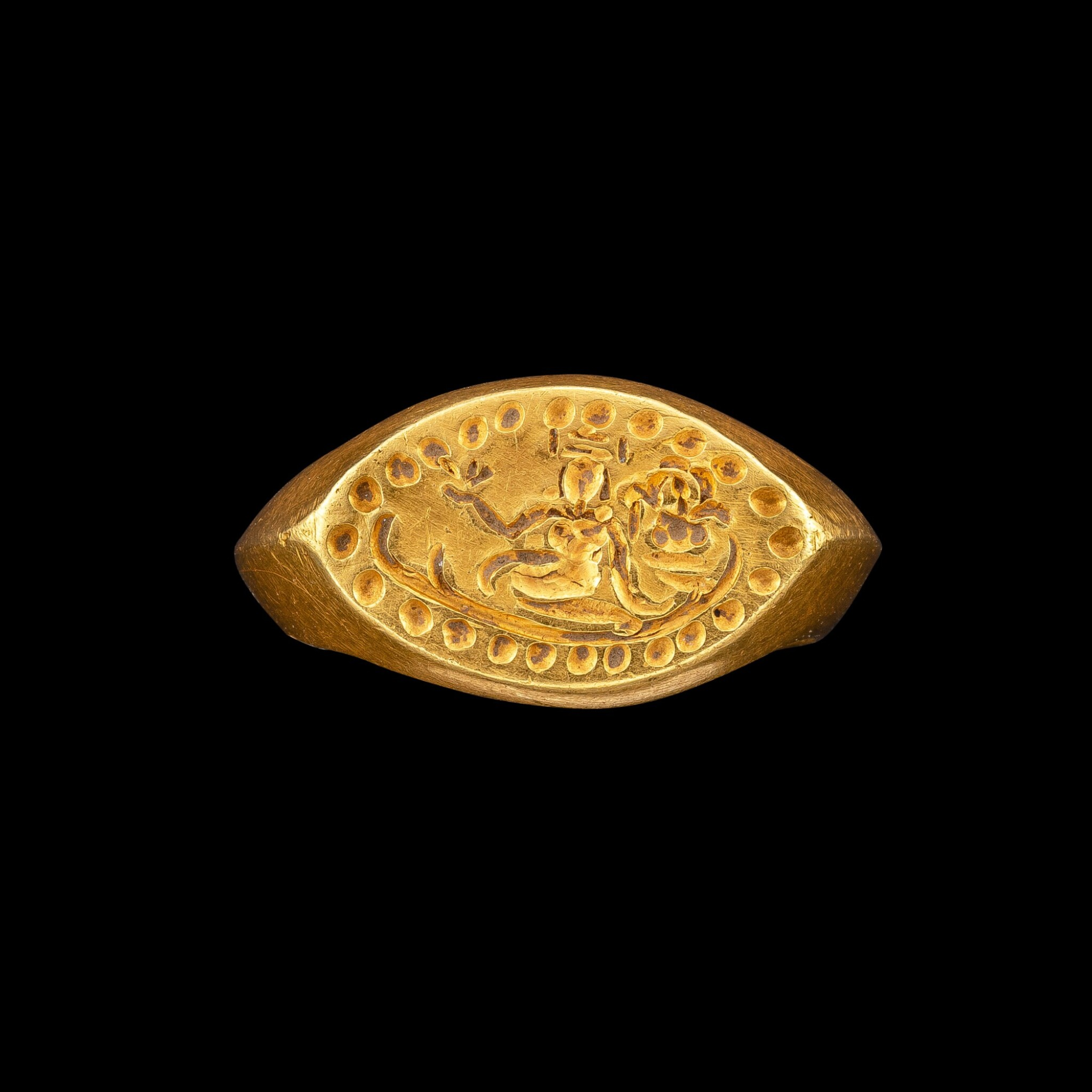 View full screen - View 1 of Lot 1093. A gold ring with an incised bezel of Lakshmi Pyu, 9th - 11th century   九至十一世紀 驃國 吉祥天女紋金戒指.