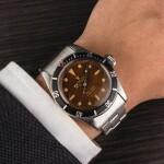 "ROLEX | Submariner, Ref. 6538, A Stainless Steel Wristwatch with 4-Line ""Tropical"" Dial and Bracelet, Circa 1958"