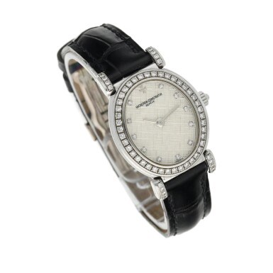 View 3. Thumbnail of Lot 92. Reference 10540   A white gold and diamond-set oval wristwatch, Circa 1994.