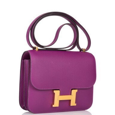 View 2. Thumbnail of Lot 21. Hermès Anemone Constance 18cm of Evercolor Leather with Gold Hardware.