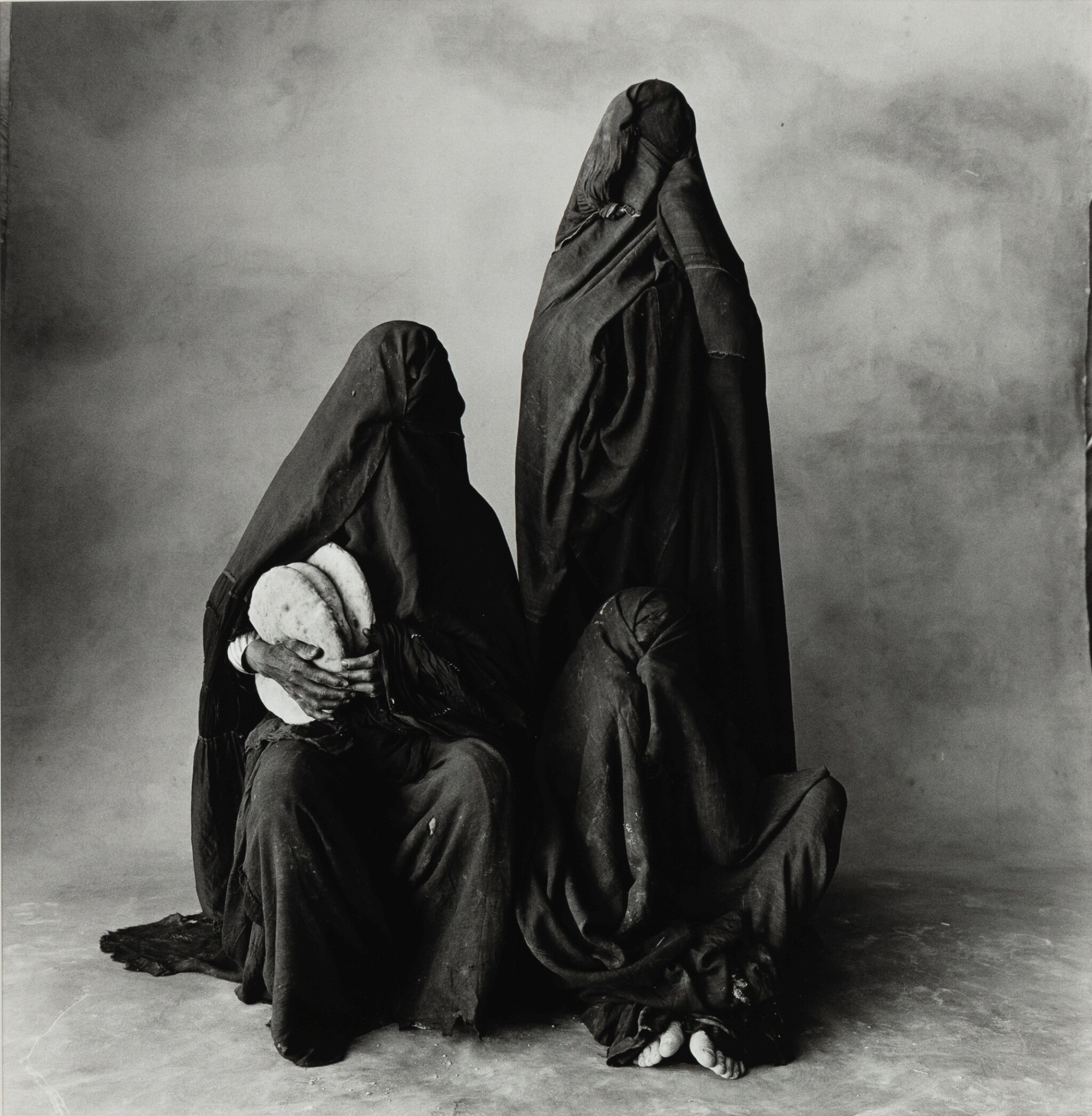 View 1 of Lot 41. IRVING PENN | THREE RISSANI WOMEN WITH BREAD, MOROCCO, 1971.