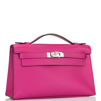 View 2. Thumbnail of Lot 15. Hermès Rose Pourpre Swift Mini Kelly Pochette.