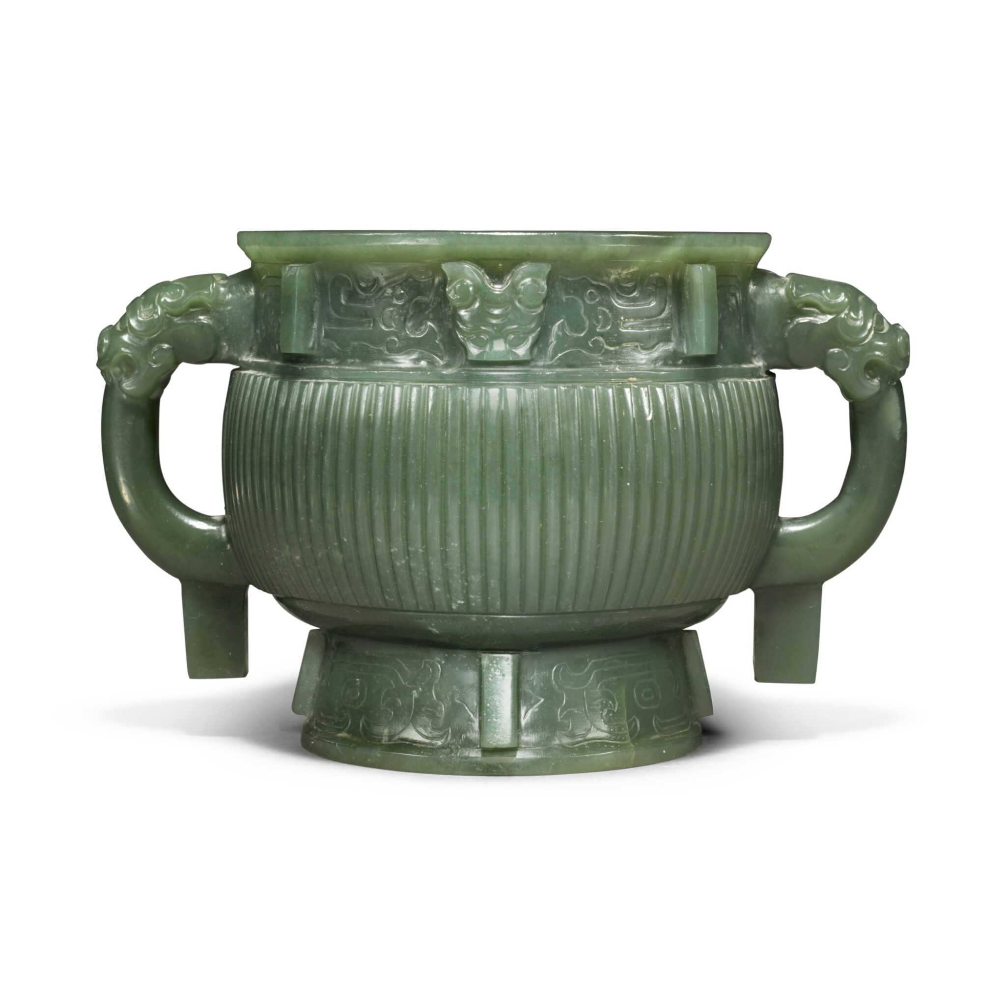 View full screen - View 1 of Lot 85. An archaistic spinach-green jade gui-form censer, Qing dynasty.