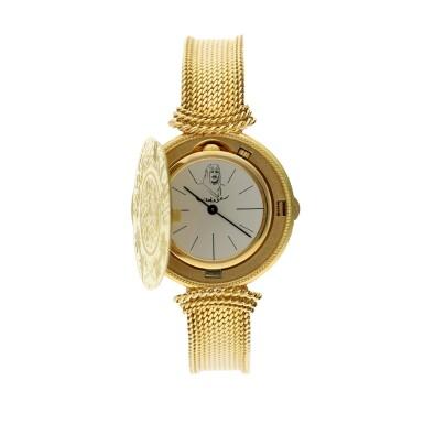 View 3. Thumbnail of Lot 66. A yellow gold coin bracelet watch, Circa 1970.