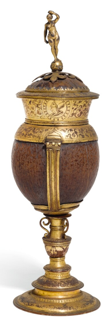 A GERMANIC GILT-COPPER MOUNTED COCONUT CUP AND COVER, UNMARKED, CIRCA 1590