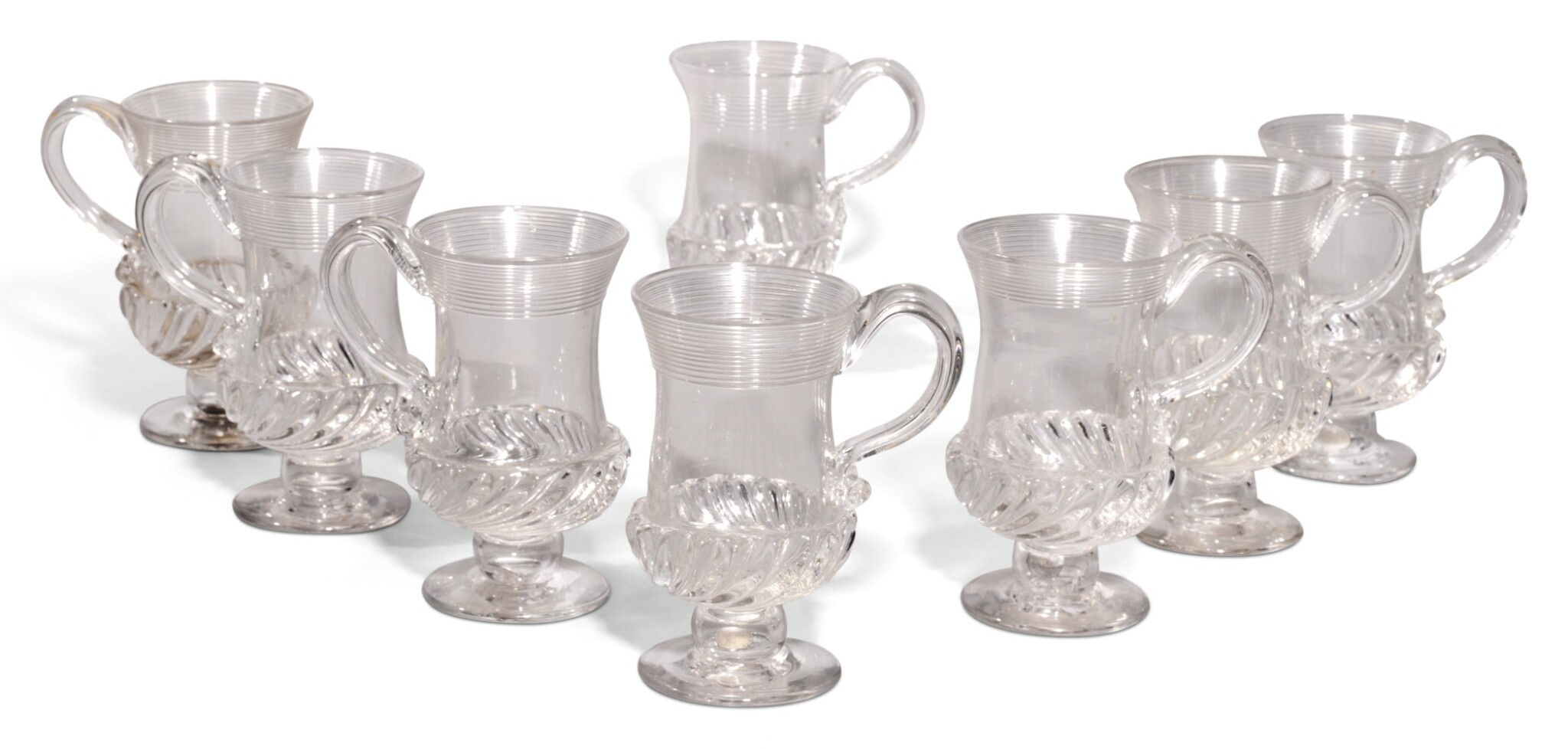 View full screen - View 1 of Lot 81. A SET OF EIGHT FLUTED GLASS COIN MUGS, 19TH/20TH CENTURY.