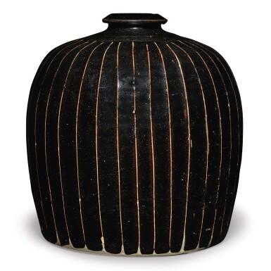 View 1. Thumbnail of Lot 128. A black-glazed 'ribbed' 'tulu' vase, Northern Song / Jin dynasty | 北宋 / 金 黑釉棱線紋小口瓶.