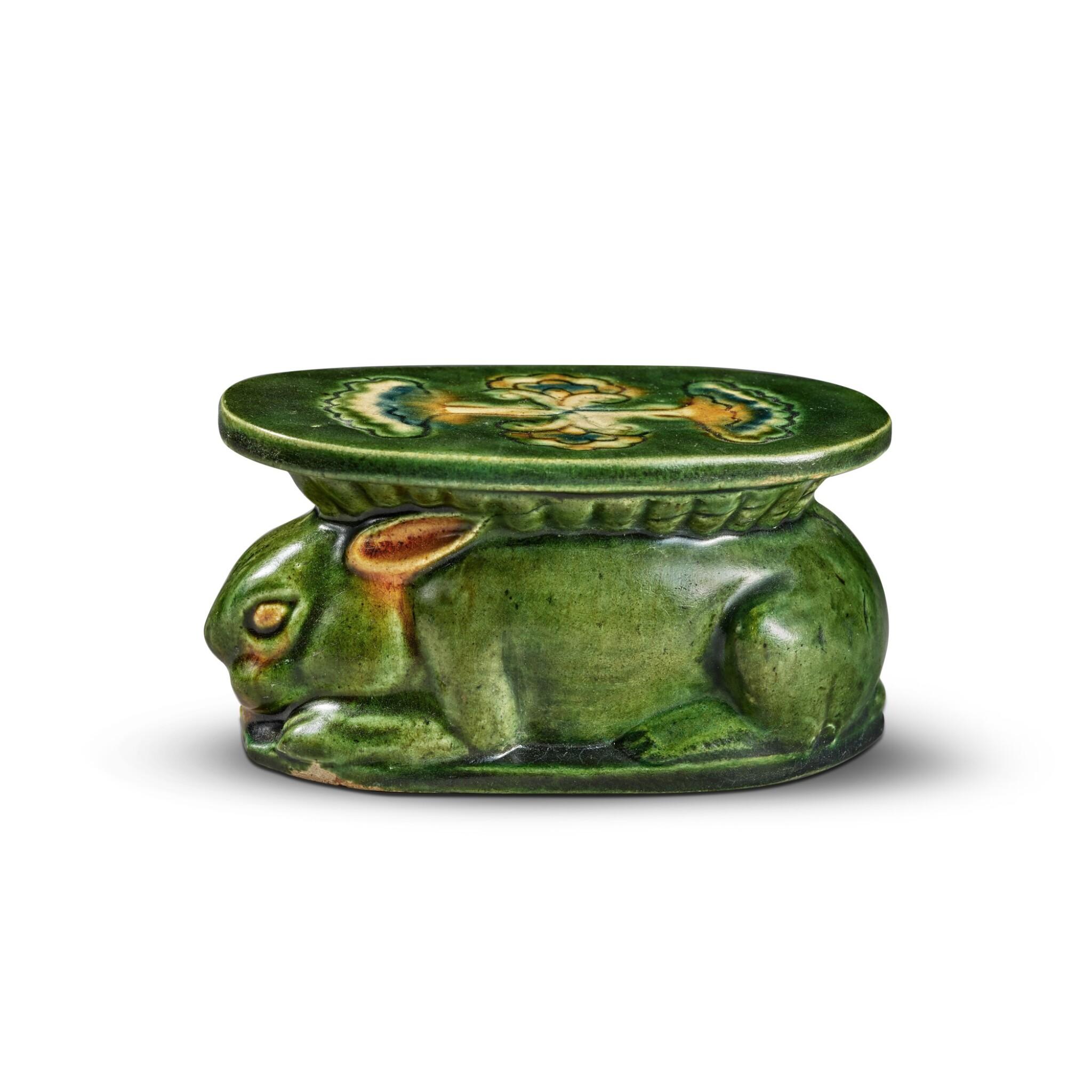 View full screen - View 1 of Lot 97. A sancai-glazed pottery 'rabbit' wrist pillow, Tang dynasty | 唐 三彩瑞兔形脈枕.