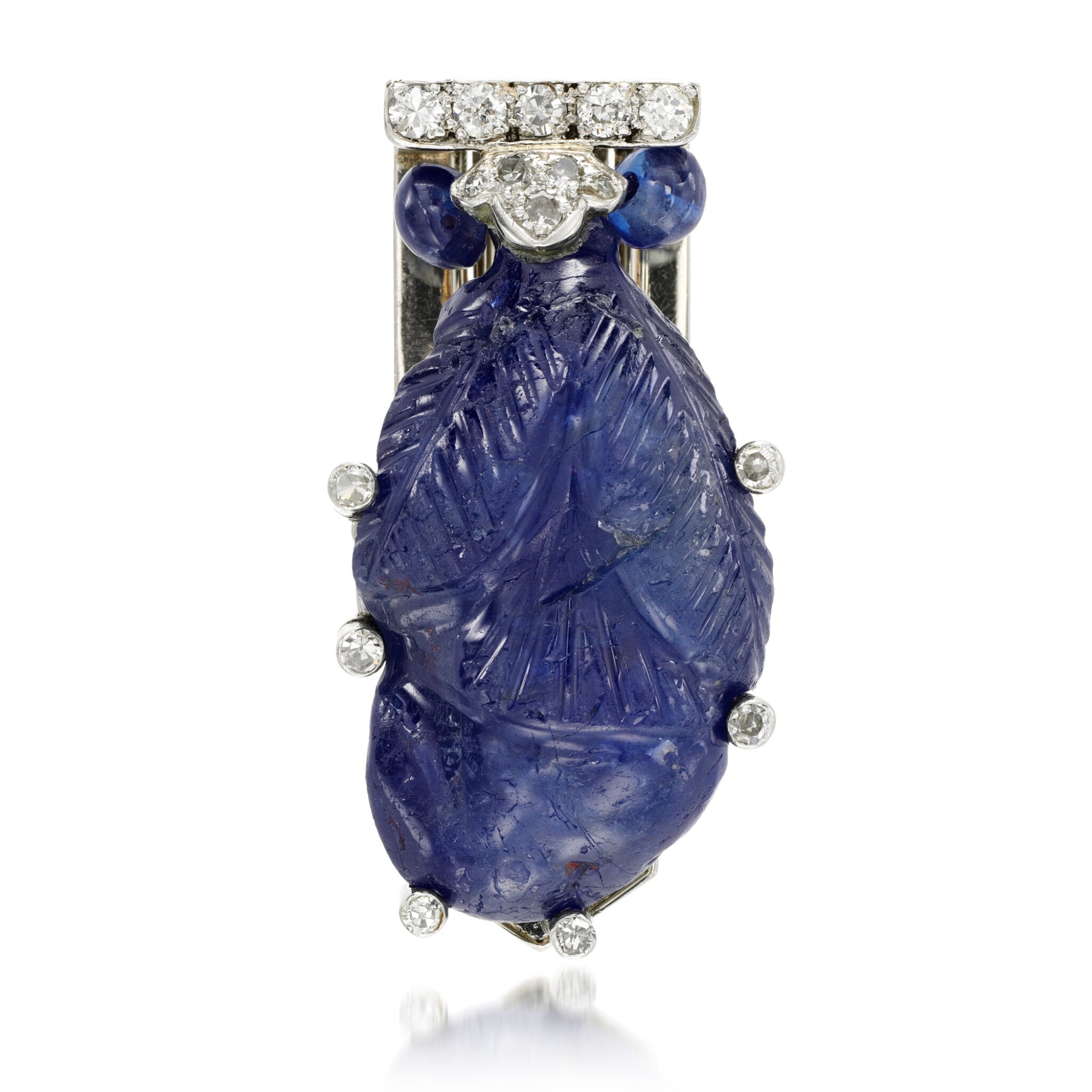 View full screen - View 1 of Lot 24. Sapphire and diamond clip brooch, 1930s.