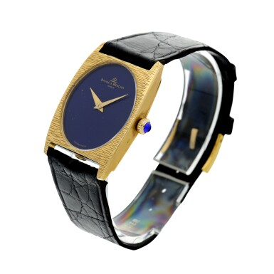 View 2. Thumbnail of Lot 1056. REFERENCE 37073 A YELLOW GOLD OVAL WRISTWATCH WITH LAPIS LAZULI DIAL, CIRCA 1980.