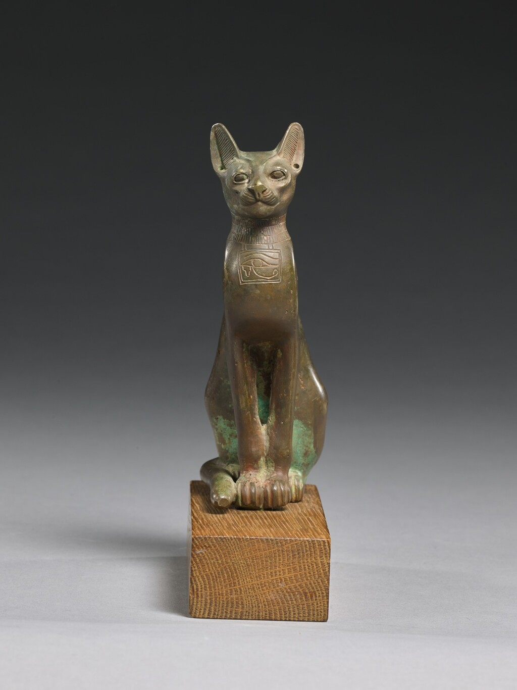 AN EGYPTIAN BRONZE FIGURE OF A CAT, 21ST/26TH DYNASTY, 1075-525 B.C.