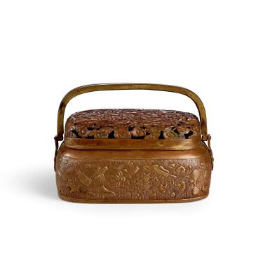 View 1. Thumbnail of Lot 3677. A rare parcel-gilt copper alloy rectangular bronze handwarmer By Hu Wenming, Late Ming dynasty   明末 胡文明製局部鎏金銅鏤空祥雲龍鳳紋手爐 《胡文明製》款.