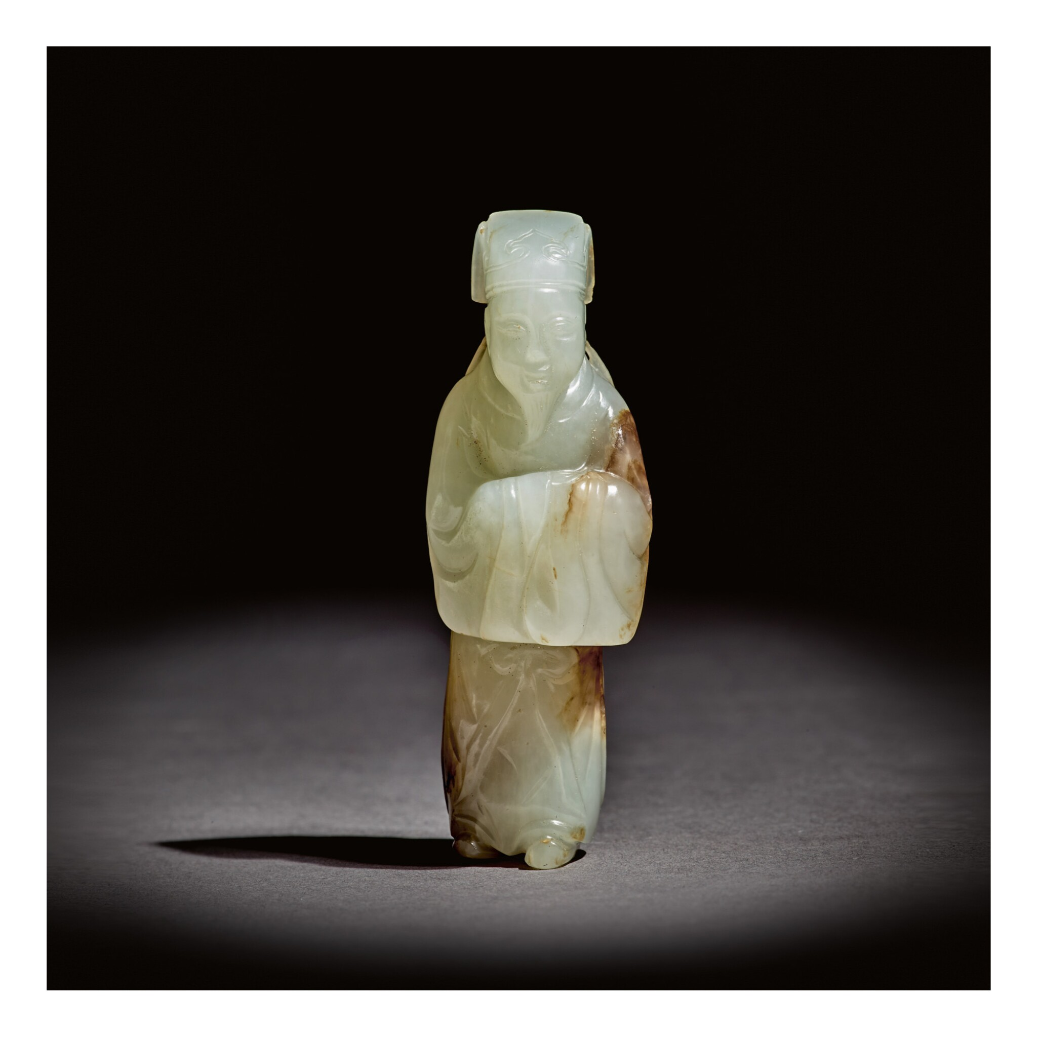 View full screen - View 1 of Lot 224. A VERY RARE WHITE AND RUSSET JADE 'SCHOLAR' PENDANT,  MING DYNASTY.