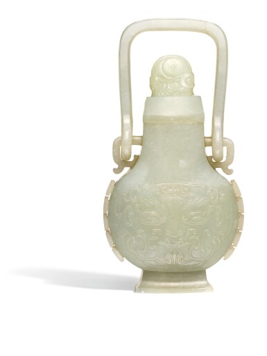 A CELADON JADE ARCHAISTIC HANGING VASE AND COVER QING DYNASTY, 18TH CENTURY | 清十八世紀 青白玉仿古饕餮紋提樑卣