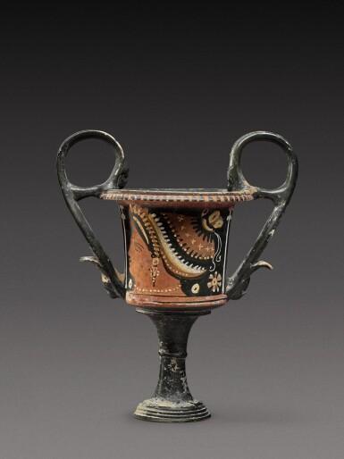View 1. Thumbnail of Lot 17. An Apulian Red-figured Kantharos, attributed to the Kantharos Group, circa 350-330 B.C..