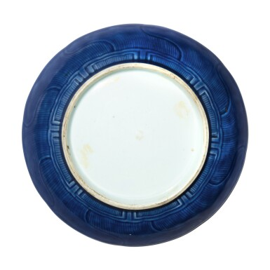 View 2. Thumbnail of Lot 115. A carved blue-glazed dish, Qing dynasty, 18th century .