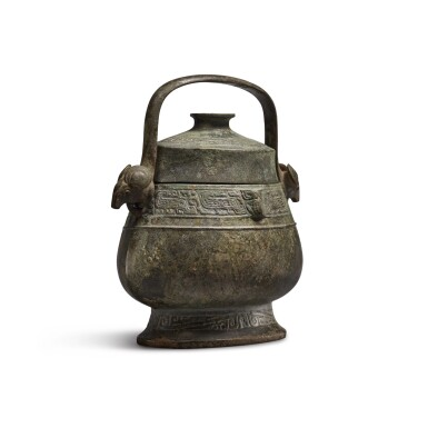 View 4. Thumbnail of Lot 6. An archaic bronze ritual wine vessel and cover (You), Western Zhou dynasty | 西周 青銅龍紋卣.