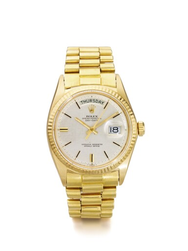 ROLEX | DAY DATE REFERENCE 1803 A YELLOW GOLD AUTOMATIC CENTER SECONDS WRISTWATCH WITH DAY AND DATE CIRCA 1970