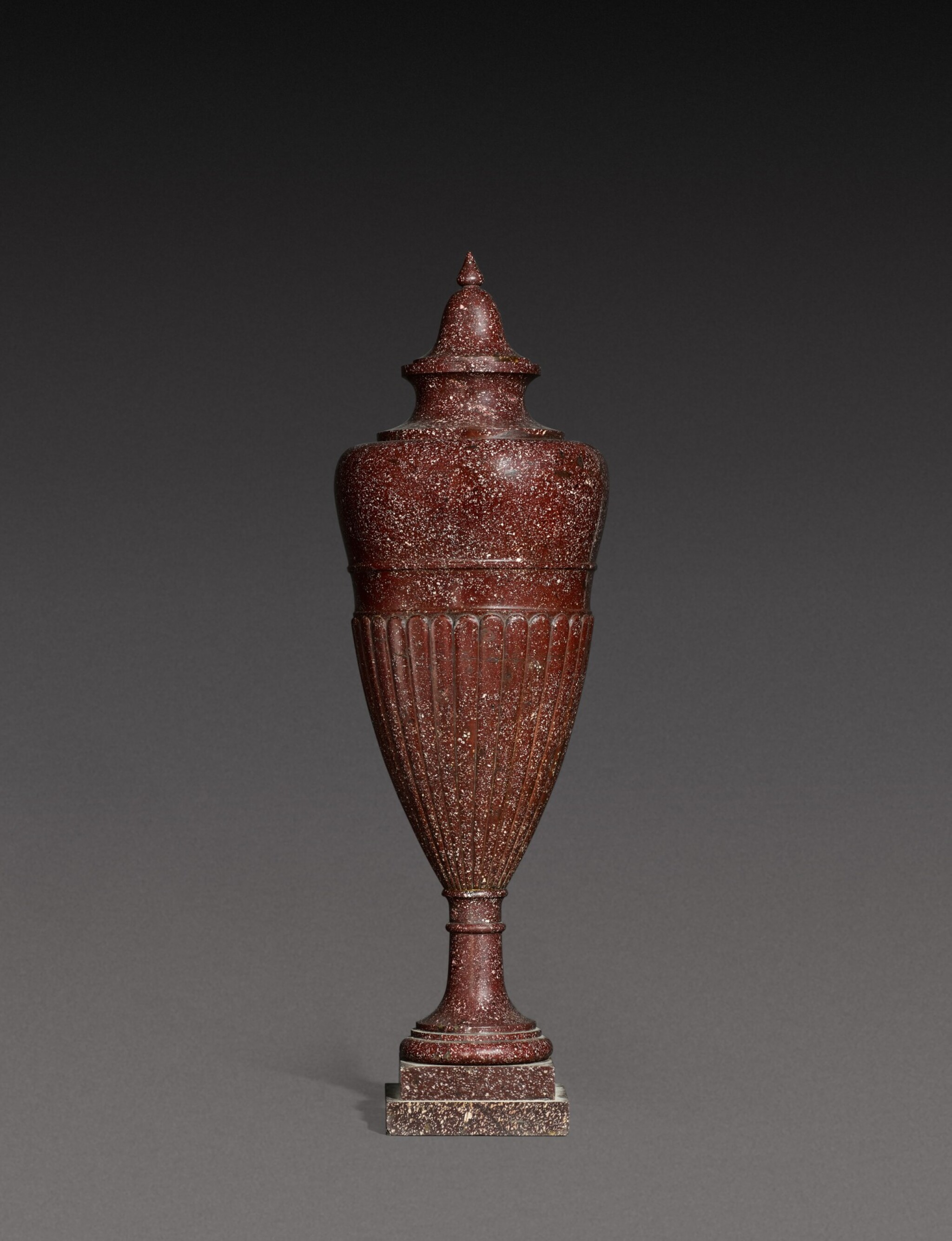 View 1 of Lot 137. An Italian carved porphyry urn, 19th century.