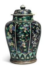 A LARGE FAMILLE-NOIRE 'BIRD AND FLOWER' BALUSTER JAR AND COVER, THE PORCELAIN 18TH CENTURY, THE ENAMELS LATER-ADDED