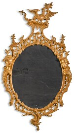 A GEORGE II CARVED GILTWOOD MIRROR, CIRCA 1758, AFTER A DESIGN BY THOMAS JOHNSON