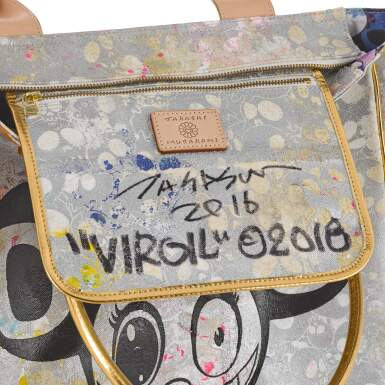 View 5. Thumbnail of Lot 3. Gold and Black Tote Bag in Canvas and Leather, 2018, signed by Murakami and Abloh.