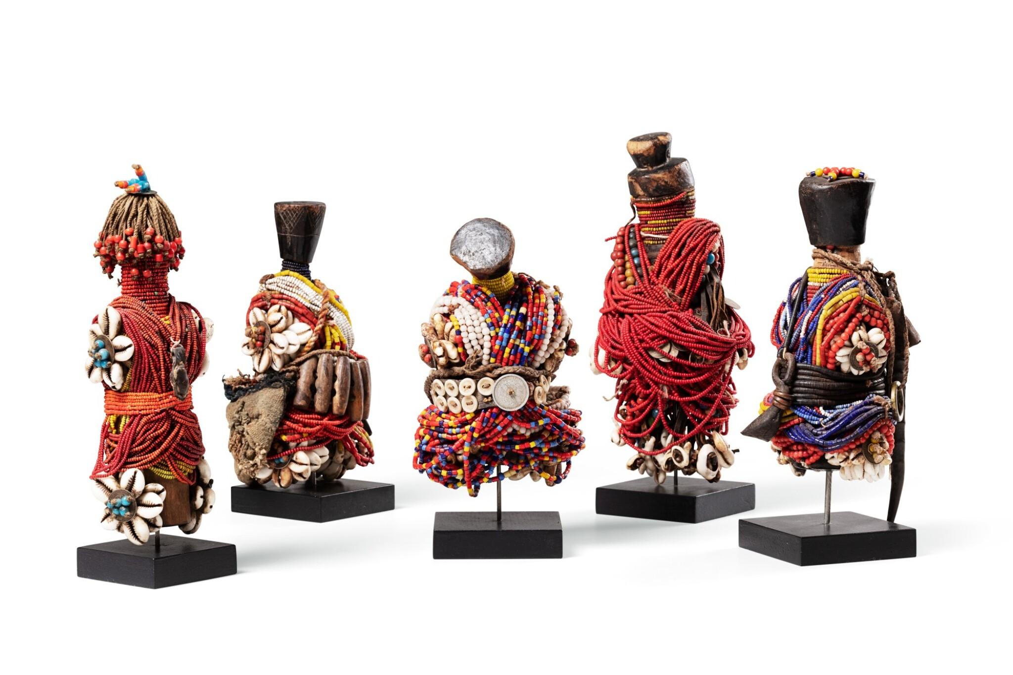 View full screen - View 1 of Lot 35. Cinq poupées, Fali, Cameroun | Five Fali dolls, Cameroun.