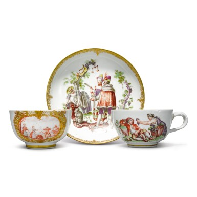A MEISSEN HAUSMALER 'MONTH' TEACUP AND SAUCER AND A MEISSEN HAUSMALER TEACUP CIRCA 1770