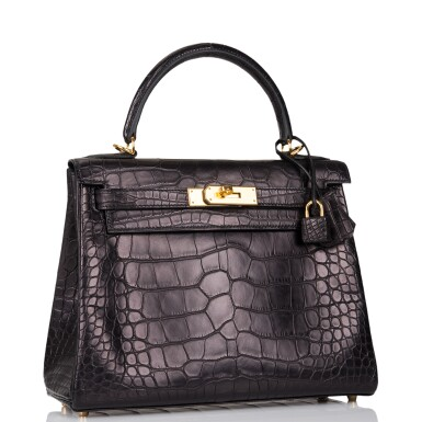View 2. Thumbnail of Lot 44. Hermès Black Retourne Kelly 28cm of Matte Alligator with Gold Hardware.