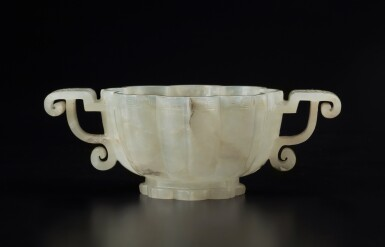 View 1. Thumbnail of Lot 51. A pale celadon jade lobed cup, Ming dynasty | 明 青白玉菱花式雙耳盃.