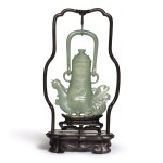 A CELADON JADE ARCHAISTIC 'PHOENIX' EWER AND COVER, QING DYNASTY, 18TH CENTURY | 清十八世紀 青玉仿古夔鳳形提梁壺