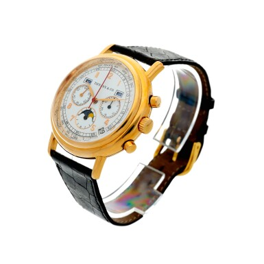 RETAILED BY TIFFANY & CO.: A YELLOW GOLD AUTOMATIC TRIPLE CALENDAR CHRONOGRAPH WRISTWATCH WITH MOON PHASES, CIRCA 1990