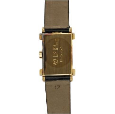 View 6. Thumbnail of Lot 137. PATEK PHILIPPE  | REFERENCE 1450 'TOP HAT' RETAILED BY RAYMOND YARD: A YELLOW GOLD RECTANGULAR WRISTWATCH, CIRCA 1950.