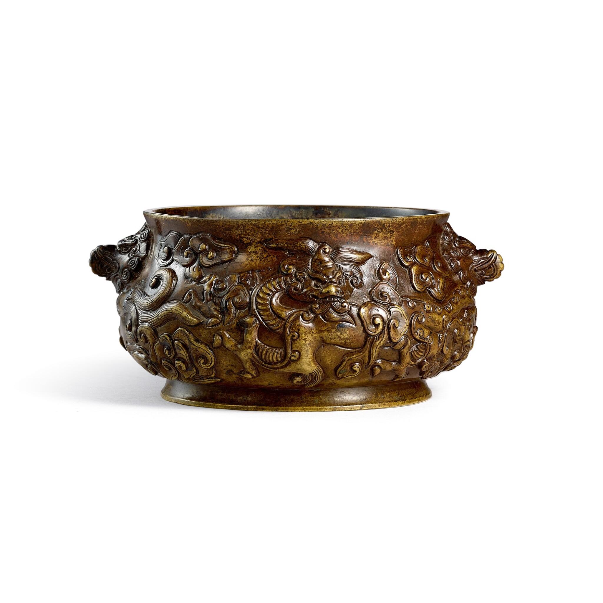 View full screen - View 1 of Lot 3669. A bronze 'dragon' incense burner Ming dynasty, Xuande mark   明 銅鏨雲龍紋獅耳簋式爐 《大明宣德年製》仿款.