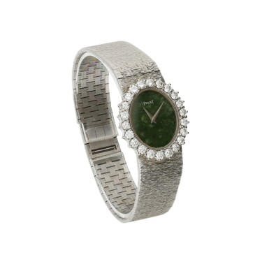 View 2. Thumbnail of Lot 63. PIAGET   REFERENCE 9338 A 6  A WHITE GOLD AND DIAMOND-SET BRACELET WATCH WITH JADE DIAL, CIRCA 1985.
