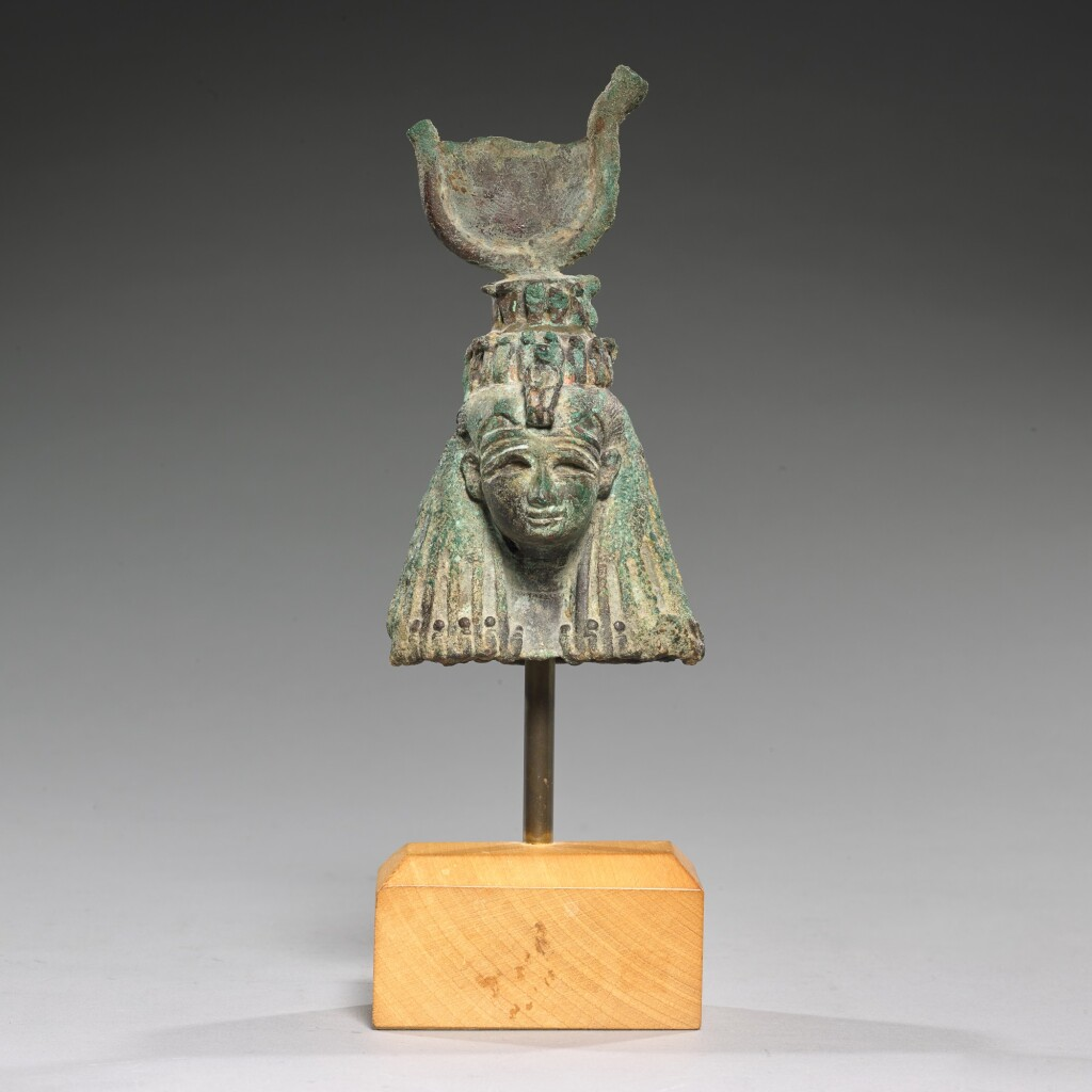 AN EGYPTIAN BRONZE HEAD OF THE GODDESS ISIS, 21ST/25TH DYNASTY, 1075-656 B.C.