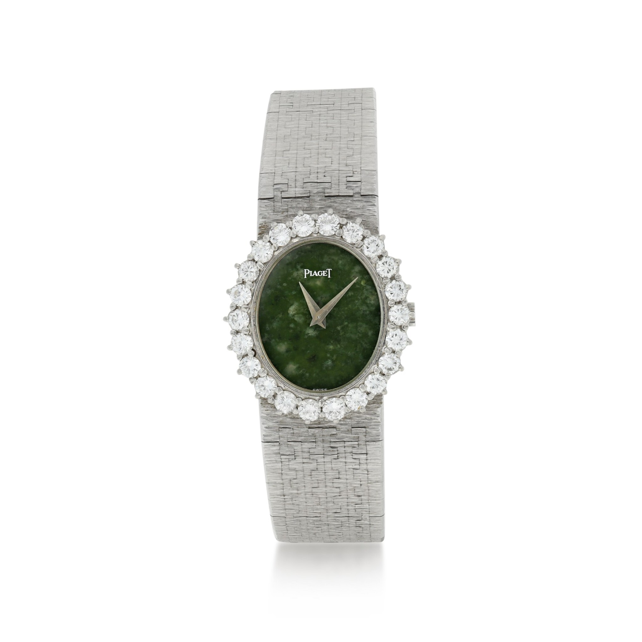 View full screen - View 1 of Lot 63. PIAGET   REFERENCE 9338 A 6  A WHITE GOLD AND DIAMOND-SET BRACELET WATCH WITH JADE DIAL, CIRCA 1985.