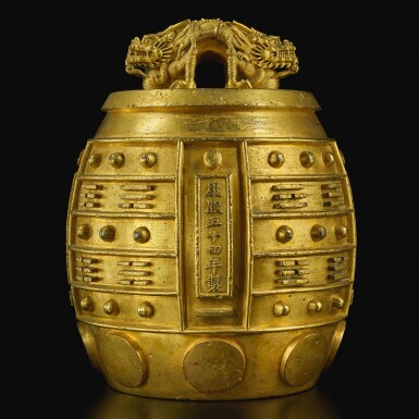 View 1. Thumbnail of Lot 169. A rare imperial gilt-bronze temple bell, bianzhong, Kangxi mark and period, dated to the 54th year, corresponding to 1715   清康熙五十四年(1715年) 銅鎏金蒲牢鈕八卦紋「黃鐘」編鐘  《康熙五十四年製》款.