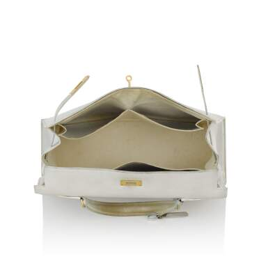 View 4. Thumbnail of Lot 12.  HERMÈS | WHITE VINTAGE KELLY SELLIER 32 IN VACHE LEATHER WITH GOLD HARDWARE, CIRCA 1960s.