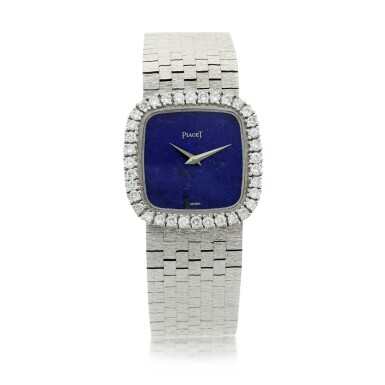 View 1. Thumbnail of Lot 111. A white gold and diamond-set cushion shaped bracelet watch with lapis lazuli dial, Circa 1970.