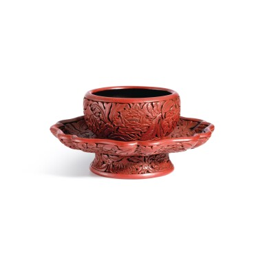 View 1. Thumbnail of Lot 3662. An exceptional and important carved cinnabar lacquer bowl stand, Ming dynasty, Hongwu period, Yongle and Xuande marks   明洪武 剔紅花卉紋盞托 《大明永樂年製》、《大明宣德年製》款.